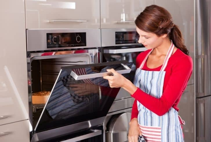 woman-checking-the-oven